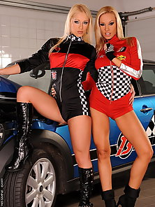 Lesbian pit girls having sex on a racing mini car
