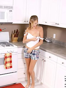 Tempting blonde hottie dares to get barebreasted in the kitchen