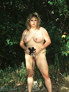 fat hot indiana jane with nothing but binoculars