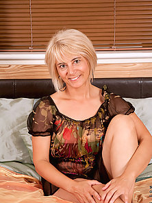 Classy blonde Anilos Dana peels off her sheer clothes revealing her alluring black bra