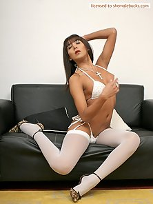 Tranny bombshell beauty in white nylons cums whackin