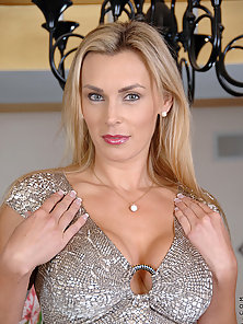 Big titted Tanya Tate slips off her evening wear and fingers her shaved Anilos pussy until she gets