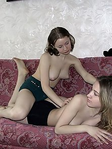 Two cute babes start with a gentle back massage and end up filming each other in the bathroom