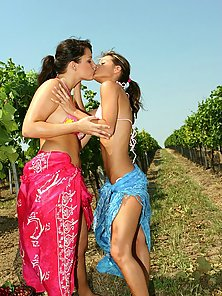 Lovely lesbian Lena and Melisa making out while working on garden