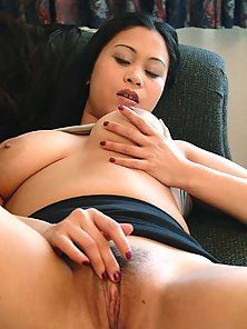 Busty asian girl strips and fingers her wet and shaved pussy