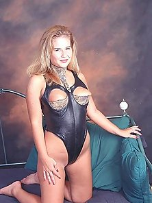 Brilliant Blondie posing in her leather lingerie