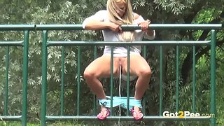 Hot Blonde Whore Madly Pissing at Outdoor in Horny Mood