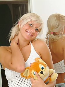 Cute teen blonde caresses her tits in front of a mirror just playing a