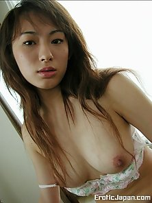 Brunette Japanese Sara showing her big jugs
