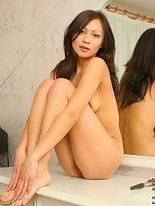 Asian hottie fantasizing her innocent body