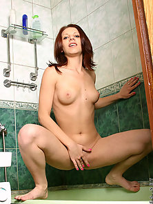Cutie is getting clean in the shower she sprays the water on her boobi
