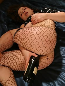 Redhead Stunning Chick in Fishnet Flaunts Pink Glistening Clit