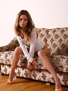 Hot Lady Posing Naughtily for Photoshoot While Sitting on Couch