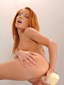 Redhead Girl Puts Dildo in Her Asshole until Satisfaction