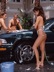 Eva Roberts in hardcore groupsex during a car wash