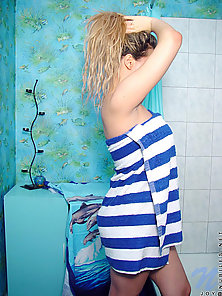 Sexy teen joy gets out of the shower and into a striped towel very sex