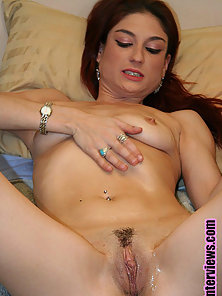 Sexy red head gets her pussy all wet after rubbing her clit