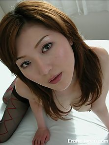 Redheaded Japanese Rio teasing us with her black nylons