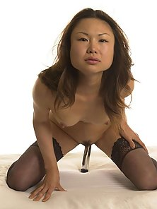Asian in panties puts a gold dildo in pussy