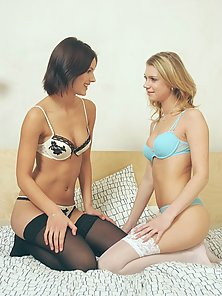 Stockings Wearing Sexy Babes on Bed Having Sensual Sex