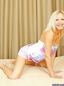 Ukrainian blonde laying on her bed stripping