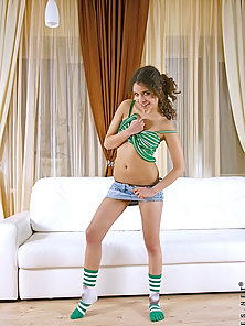 Long haired teen Dachuki flirts on the camera and ready to striptease