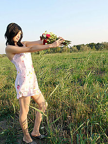 Sweet long haired amateur posing with all the flower she gets
