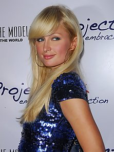 Hot blonde Paris Hilton wears sexy dress showing off cleavage