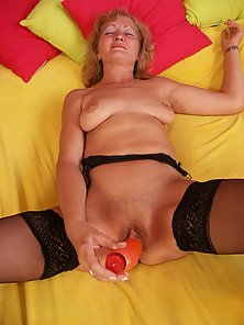 Nasty granny plays with her red rubber toy