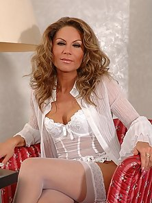 Mature Jessica teases us with her sexy white lingerie
