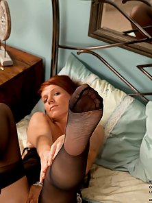 Pink pussy redhead playing with herself on her bed