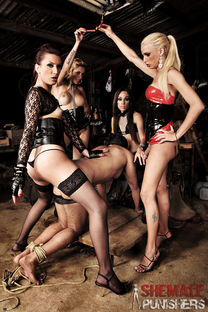 Group of tranny dommes gangbang this poor slave