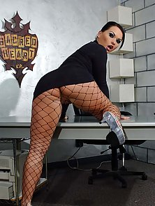 Katja Kassin in black fishnets shows off her body before putting a cock in her ass.