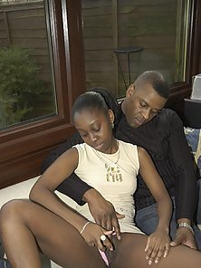 Horny ebony couple pounding hard on the couch