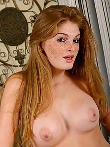 Topless seductive nubile with great sex appeal slowly stripping her ti