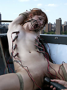 Pinky Lee is tied on a rooftop, shocked, and cum