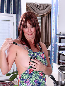 Mature redhead Lily turns cooking into an orgasmic experience