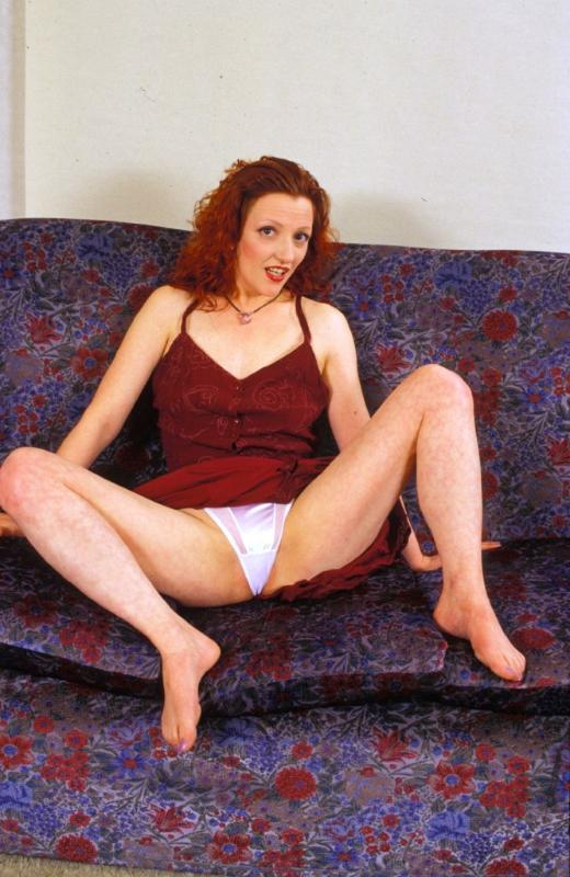 Lusty redhead mature spreaded clit in the sofa