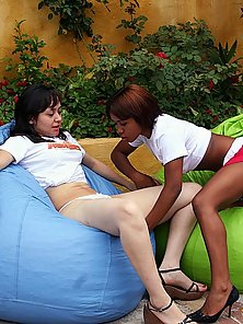 Petite lesbians licking and fisting each other outdoors