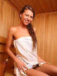Teen in sauna exposes and rubs her bald pussy