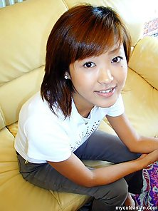 Horny asian amateur teen is stripping on the sofa and posing nude