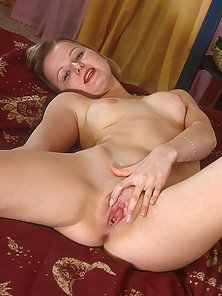 Beautiful Whore Deeply Fingers Her Pink Pussy in Bedroom