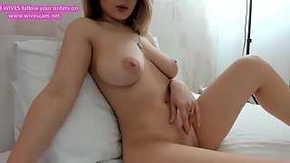Gorgeous Girl Puts Dildo in Her Tight Pussy with Enjoyable Feelings