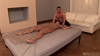 Tied up brunette Melanie Memphis gets pleased by her maledom