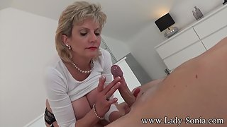 Big Boobs Mature Sonia Gives Handjob to Her Partner Big Cock