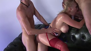 Curvy blonde babe in red stockings gets fucked by handsome studs